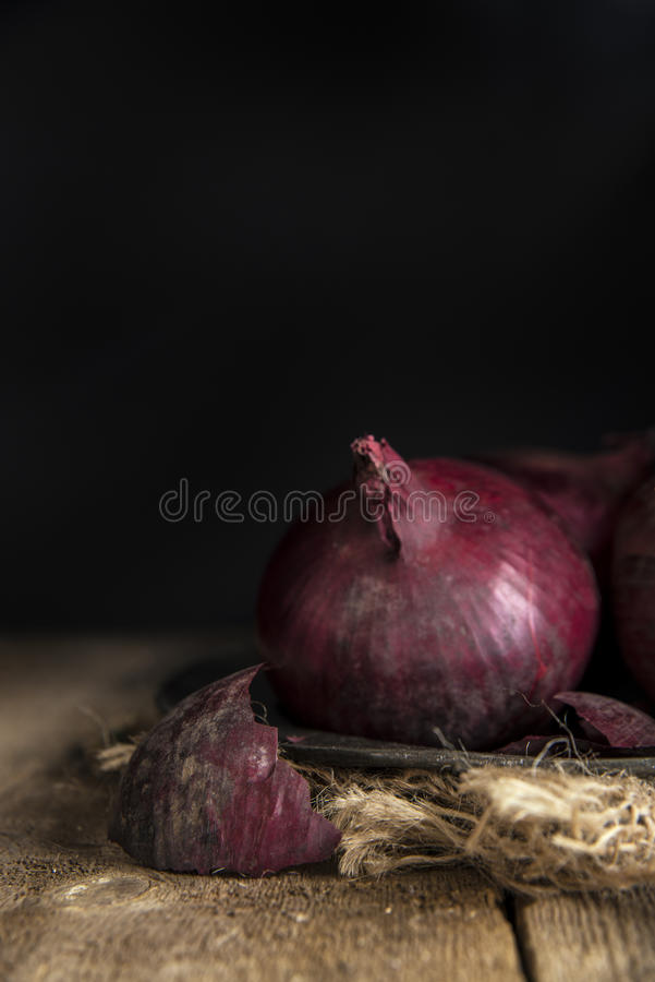 Moody natural light vintage retro style image of fresh red onion. Moody natural light vintage style image of fresh red onions stock photo