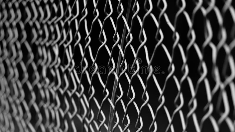 Moody shot of a fence in the dark royalty free stock photos