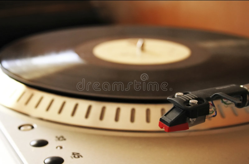Moody shot of turntable. And record royalty free stock photography