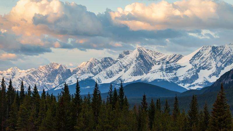 A moody sky at sunrise over a mountain range in Kananaskis Country, Alberta. Canada royalty free stock photo