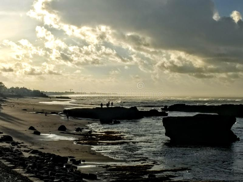 Moody sunrise over Old Man`s Beach, Bali, Indonesia stock images