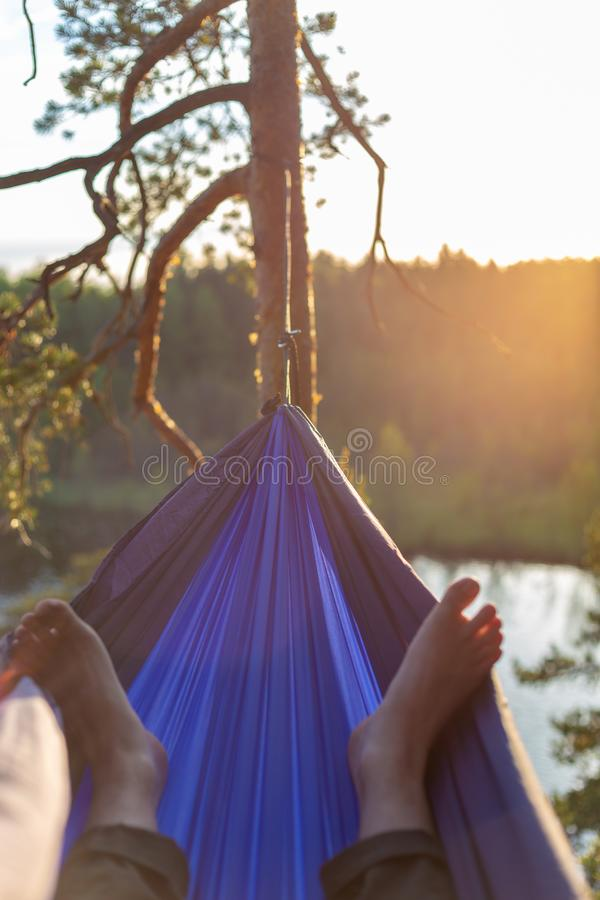 Moody sunset photo of a man in a hammock. royalty free stock image