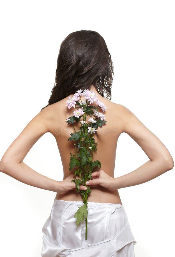 Mooi achtermeisje met bloem stock foto's