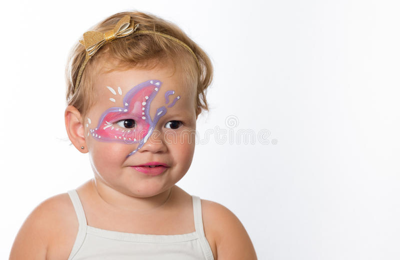 Mooi babymeisje met schilderijen op haar gezicht van een vlinder royalty-vrije stock foto's