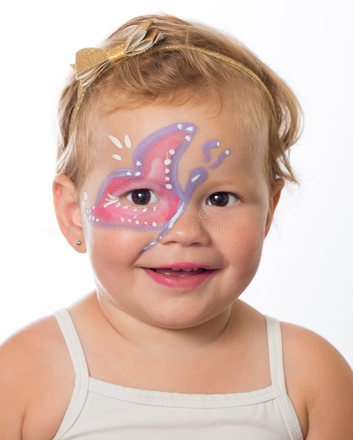 Mooi babymeisje met schilderijen op haar gezicht van een vlinder stock fotografie