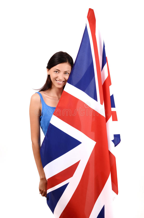 Mooi Brits meisje die steunend de Britse vlag glimlachen. stock afbeeldingen