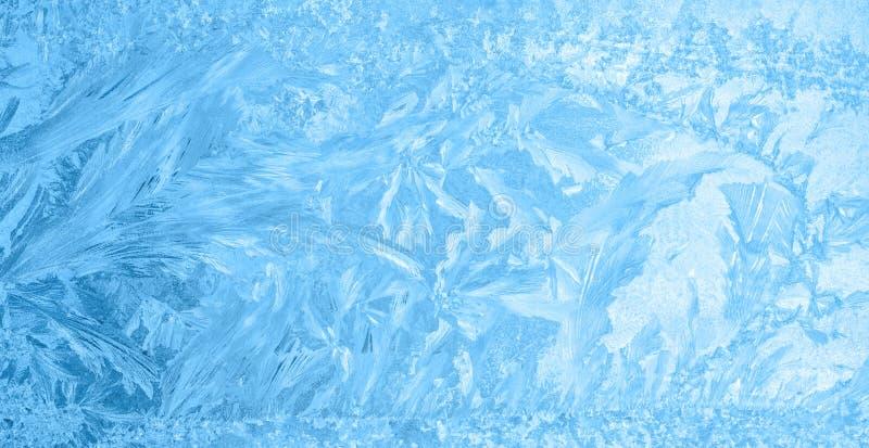 Mooi de winterijs, blauwe textuur op venster, feestelijke achtergrond stock fotografie