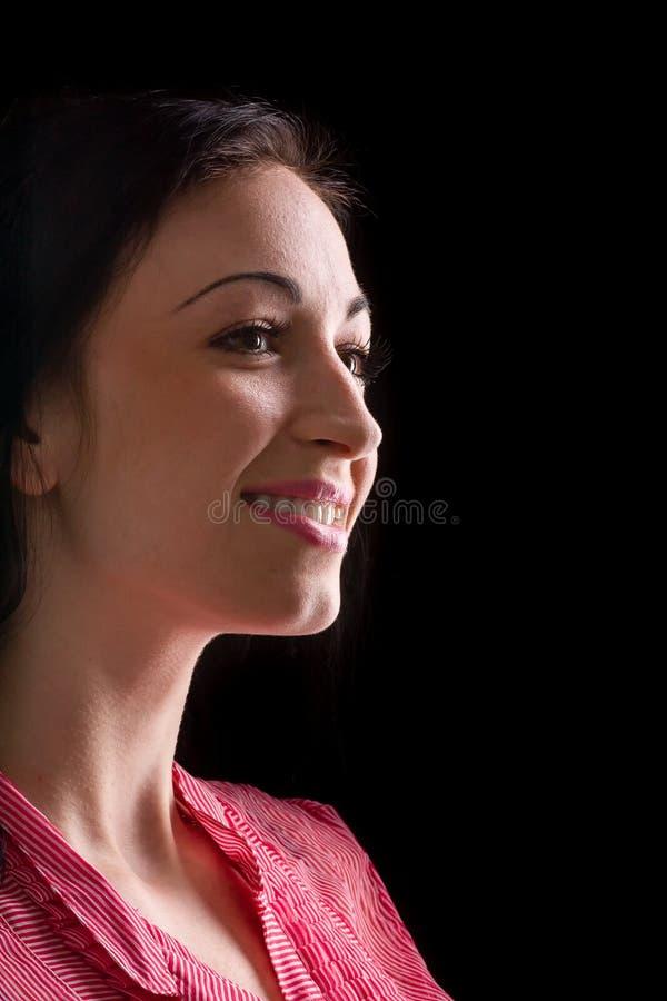Mooi die vrouwenprofiel op zwarte wordt geïsoleerd royalty-vrije stock afbeelding