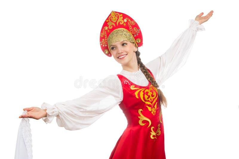 Mooi glimlachend Russisch meisje in volkskostuum stock afbeelding