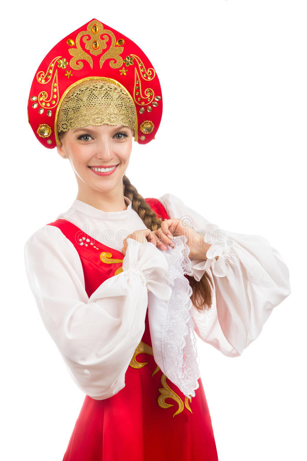 Mooi glimlachend Russisch meisje in volkskostuum stock foto