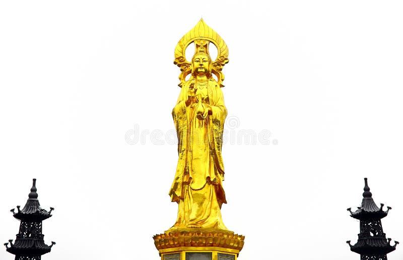 Mooi gouden standbeeld van kwan yin bij de heuveltoevlucht van de panyulotusbloem, guangzhou, China stock afbeelding