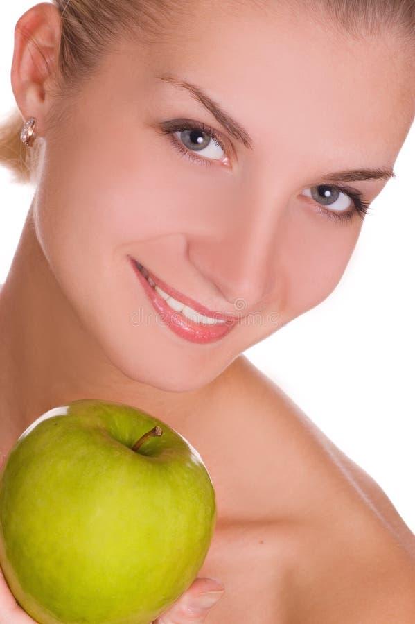 Mooi jong meisje met groene appel stock foto