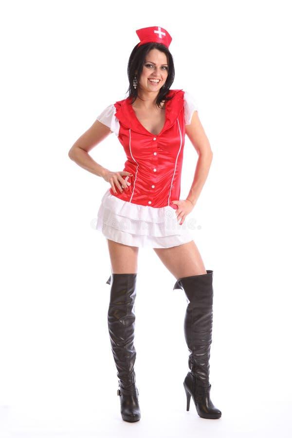 Mooi jong meisjes sexy laarzen en verpleegsterskostuum royalty-vrije stock fotografie