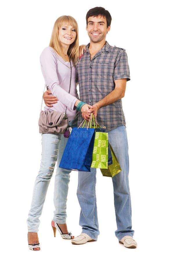 Mooi jong paar met het winkelen zakken stock foto