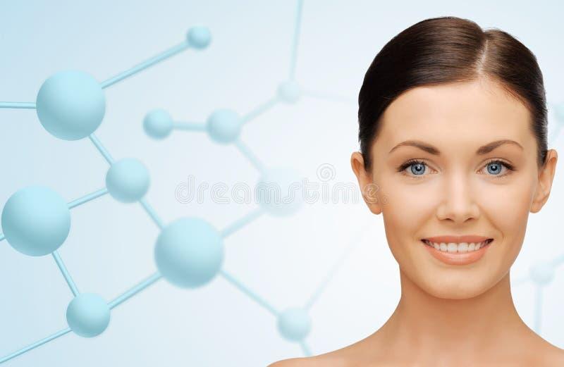 Mooi jong vrouwengezicht met molecules stock foto