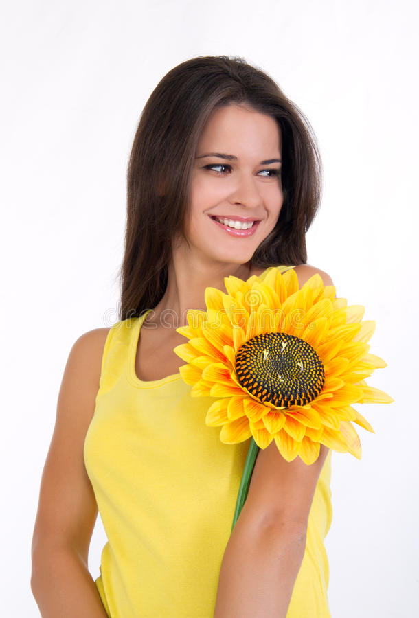 Mooi jong wijfje met een zonnebloem royalty-vrije stock foto's