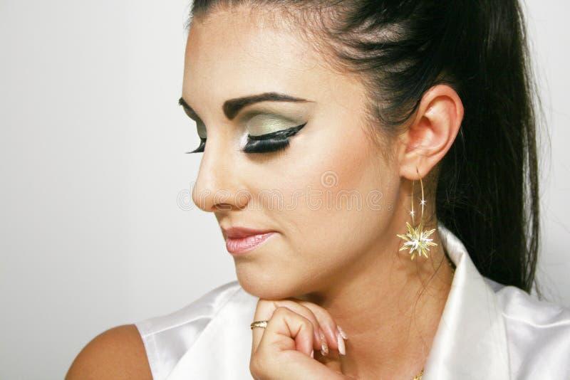 Mooi make-upmeisje met groene make-up royalty-vrije stock afbeeldingen