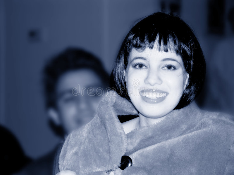 Mooi meisje in blauw stock afbeelding