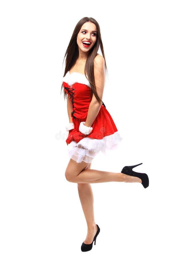 Mooi meisje dat de kleren van de Kerstman draagt stock foto