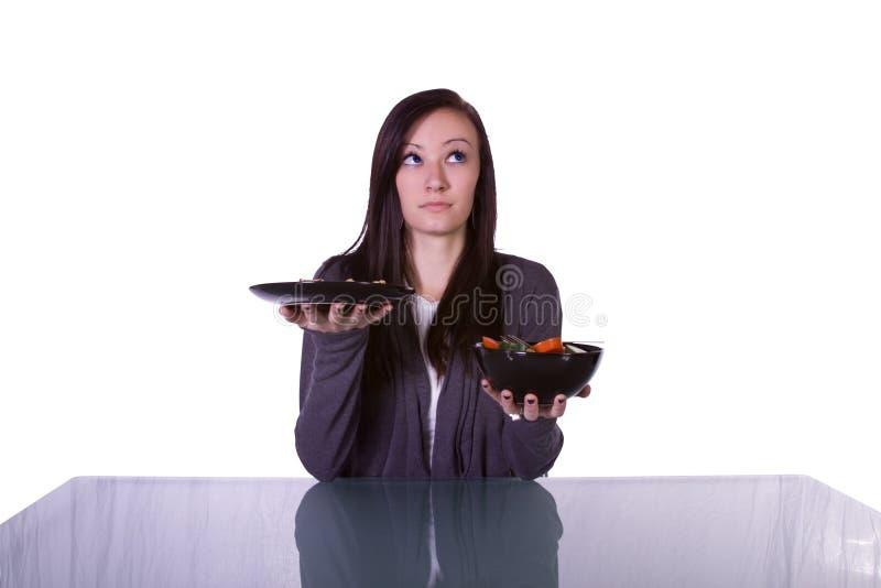 Mooi Meisje dat Te eten wat beslist royalty-vrije stock afbeeldingen