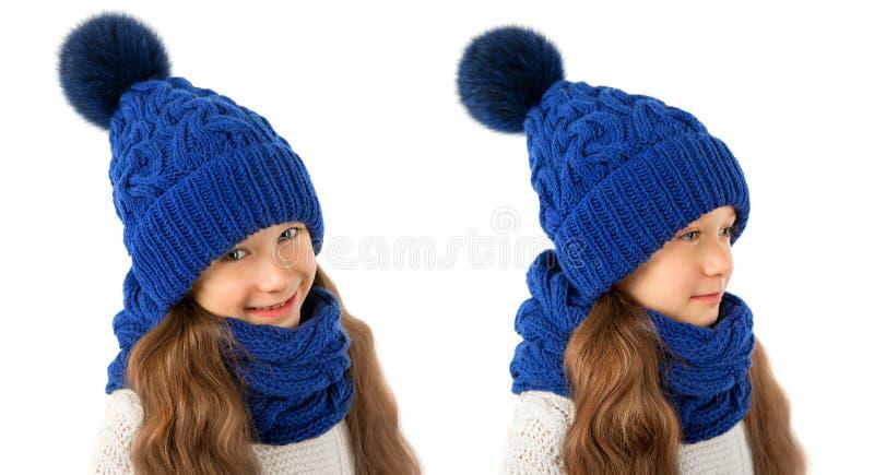 Mooi meisje in de winter warme blauwe hoed en sjaal op wit De kleren van de kinderenwinter stock foto