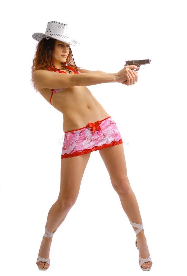 Mooi meisje die met een kanon schieten stock afbeeldingen