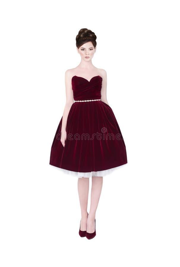 Mooi meisje in donkerrode kleding stock afbeeldingen