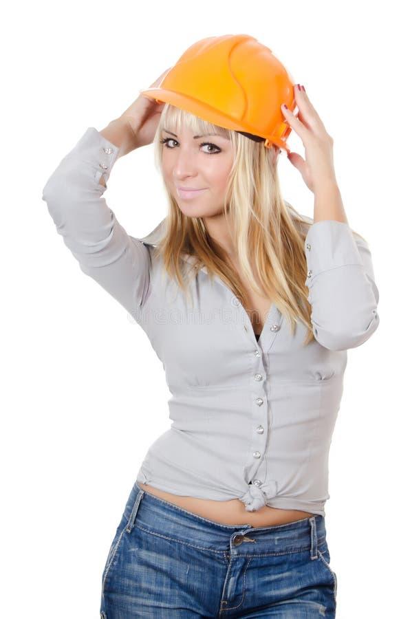 Mooi meisje in een de bouwhelm stock foto