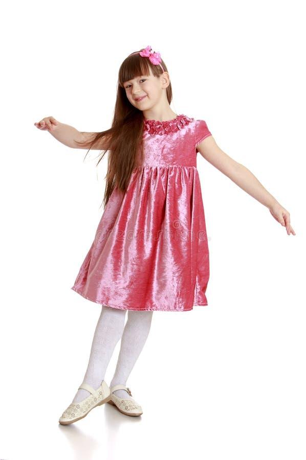 Mooi meisje in een fluweelkleding stock afbeelding