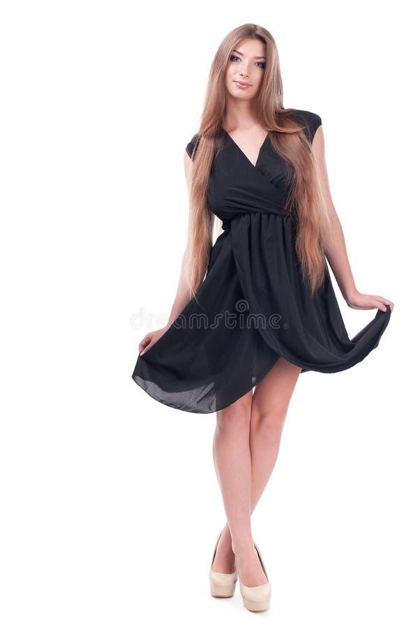 Mooi meisje in een kleding stock foto