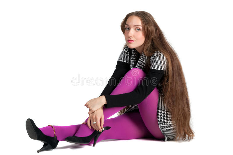 Mooi meisje een sittinh op de vloer. stock afbeelding