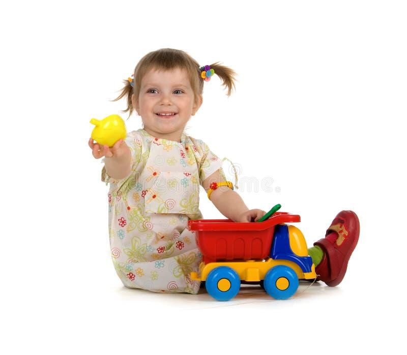 Mooi meisje en haar speelgoed royalty-vrije stock foto's