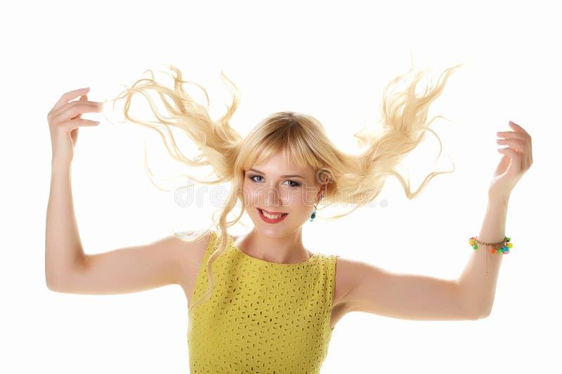Mooi meisje in gele die de zomerkleding op wit wordt geïsoleerd royalty-vrije stock foto's