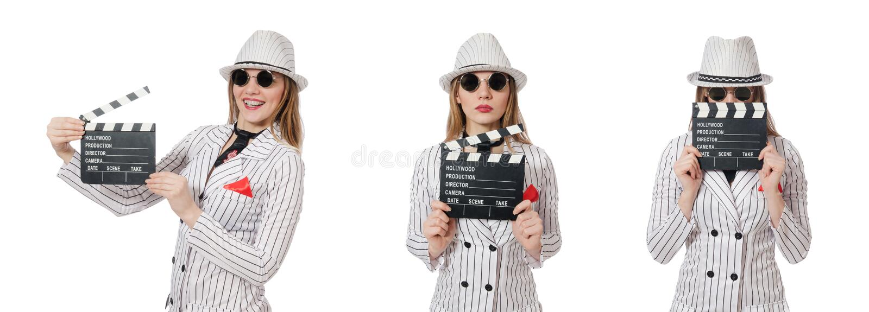 Mooi meisje in gestreepte geïsoleerde kledingsholding clapperboard stock foto's