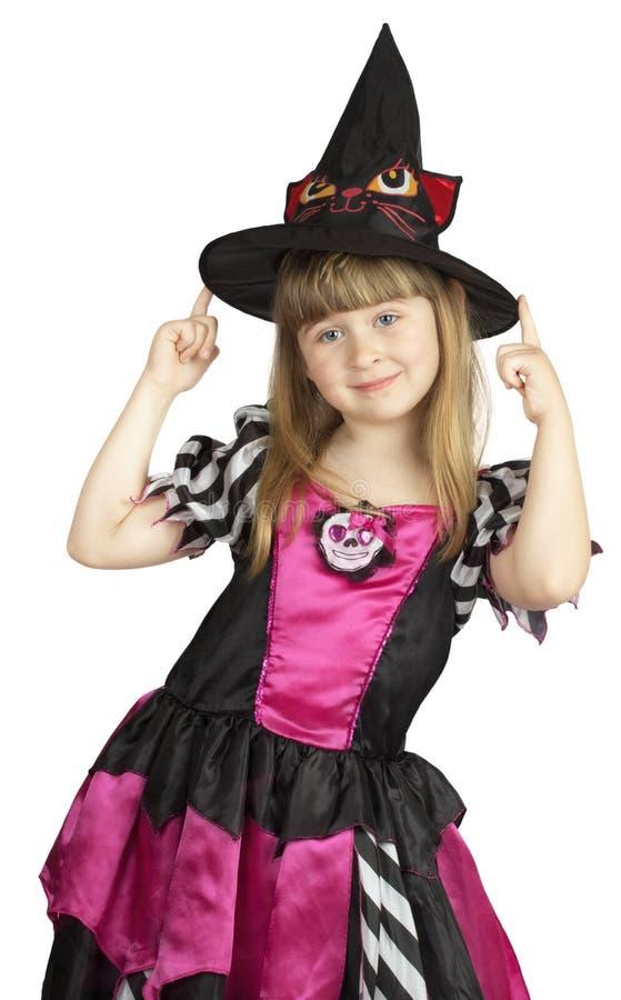Mooi meisje in heksenkostuum op de witte achtergrond royalty-vrije stock foto