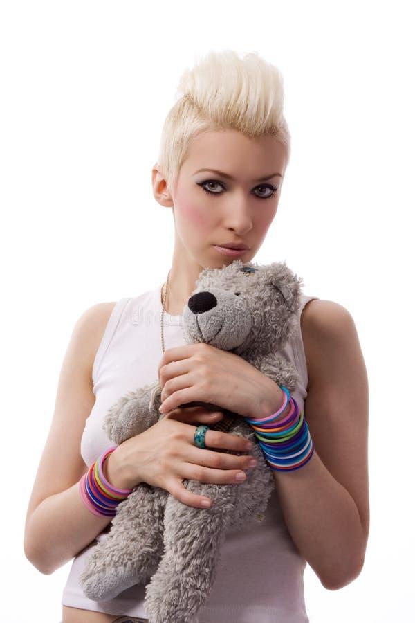Mooi meisje met blonde haar en Teddy stock foto's