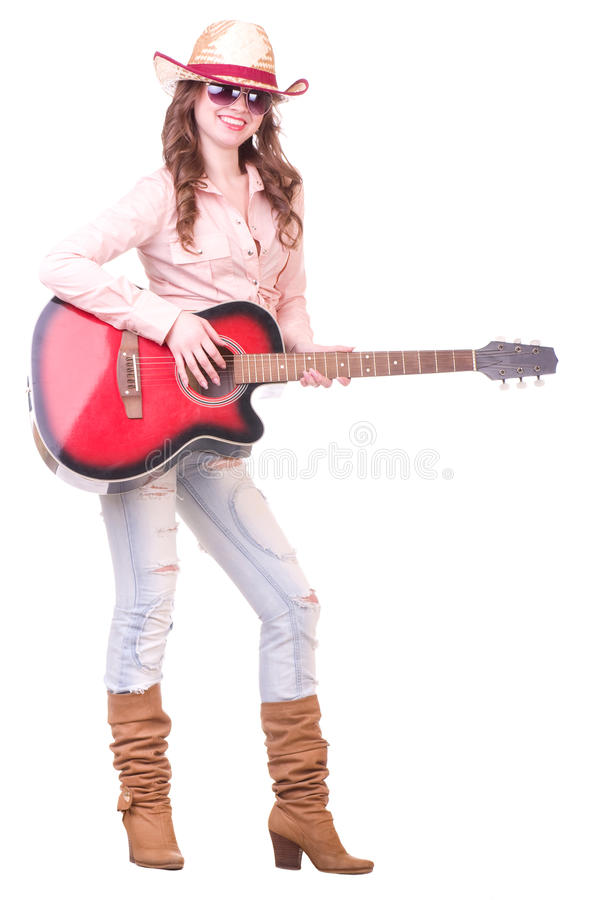 Mooi meisje met cowboyhoed met gitaar stock foto's