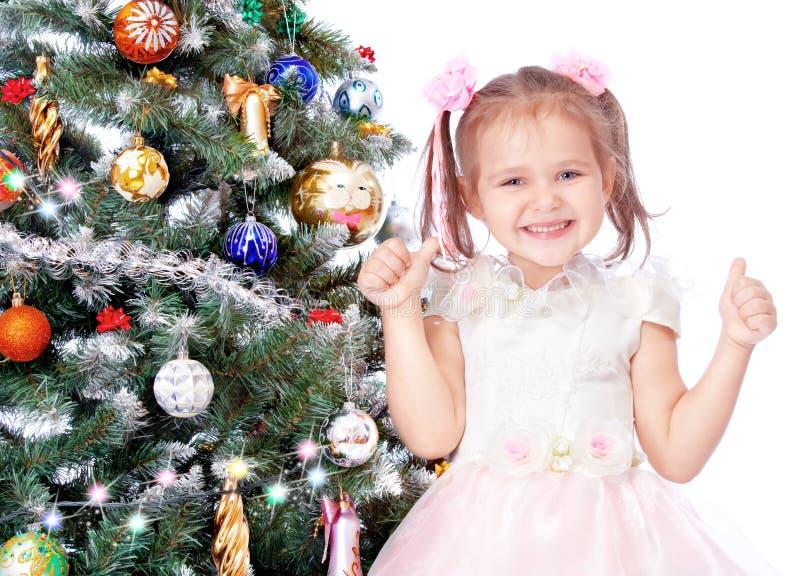 Mooi meisje met een Kerstboom stock afbeelding