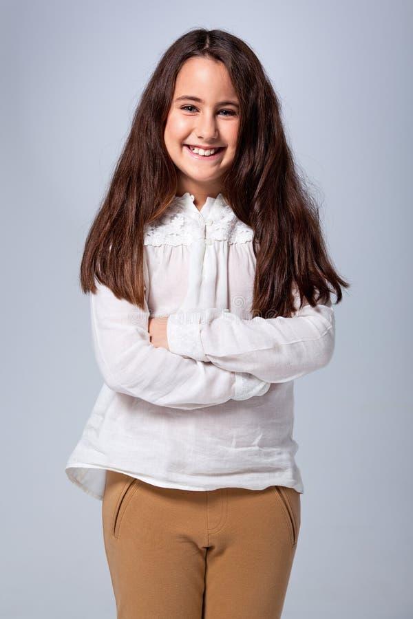 Mooi Meisje met Gekruiste Wapens royalty-vrije stock foto