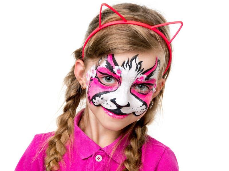 Mooi meisje met helder geschilderd gezicht stock afbeeldingen