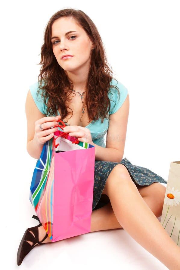 Mooi meisje met het winkelen zakken stock foto