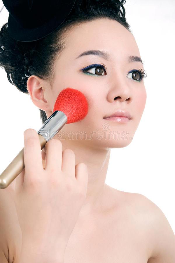Mooi meisje met perfecte make-up stock afbeelding