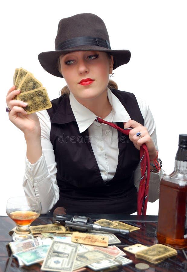 Mooi meisje met speelkaarten en kanon stock afbeelding