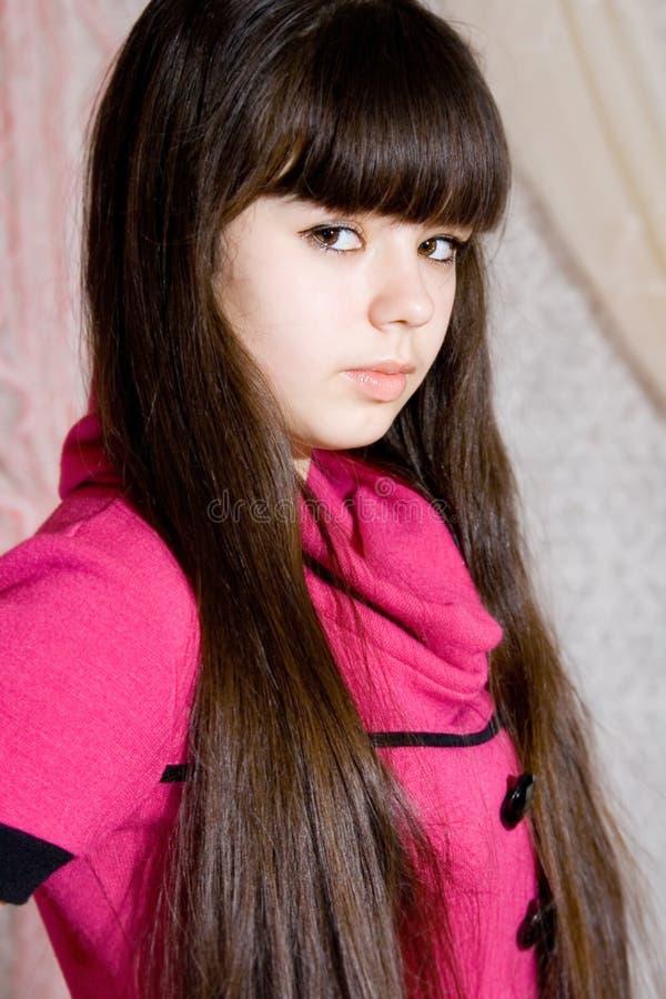 Mooi meisje in roze kleding royalty-vrije stock foto