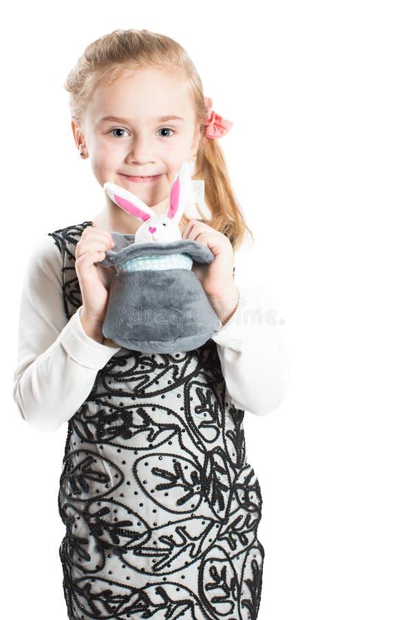Mooi meisjeskind met stuk speelgoed stock foto