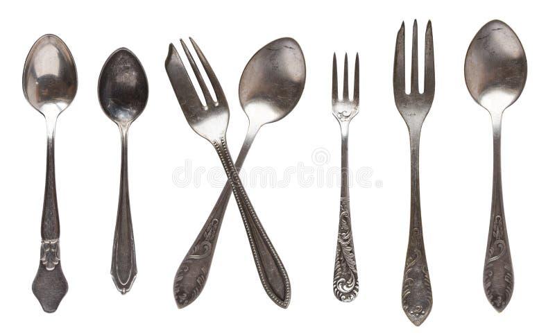 Mooi oud uitstekend lepels en mes dat op witte achtergrond worden ge?soleerd Hoogste mening Retro tafelzilver royalty-vrije stock afbeelding