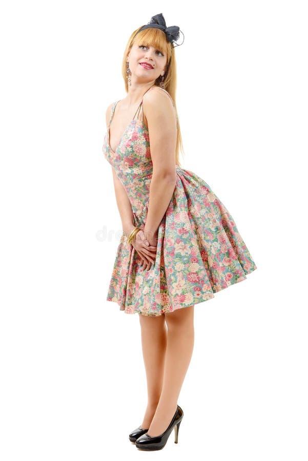 Mooi pinupmeisje met een kleurrijke kleding royalty-vrije stock foto's