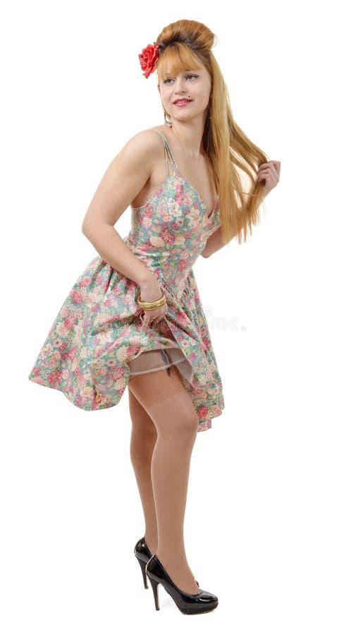Mooi pinupmeisje met een kleurrijke kleding stock afbeeldingen