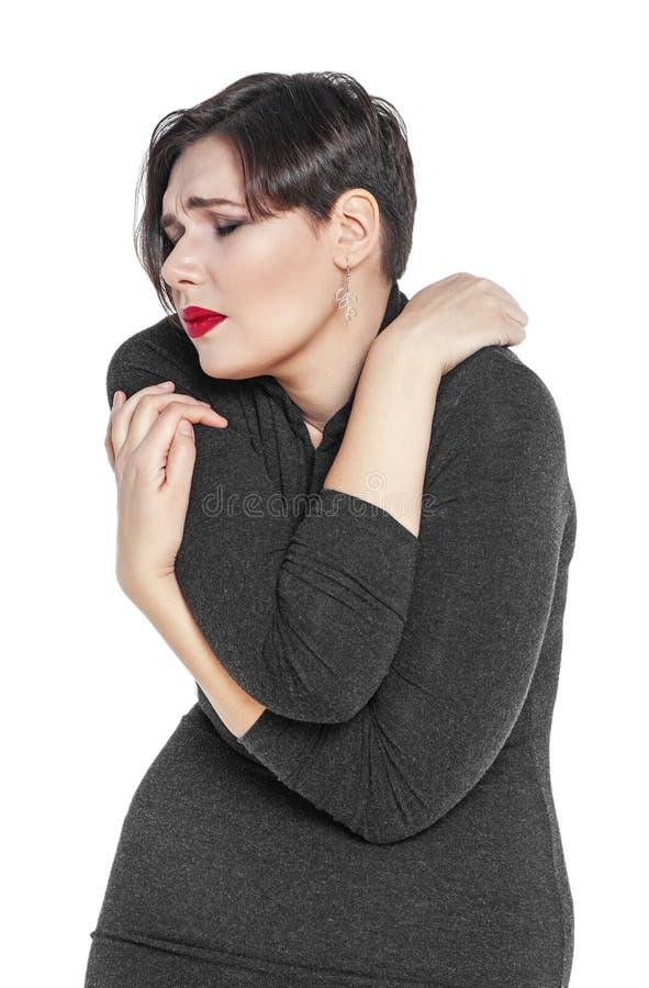 Mooi plus groottevrouw met pijn in haar geïsoleerd lichaam stock foto