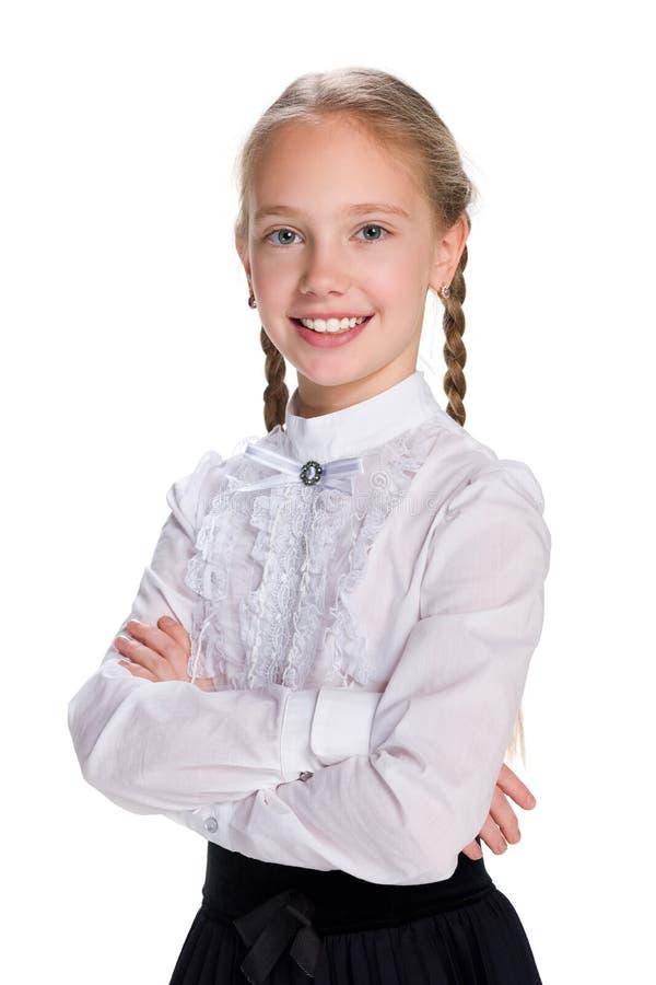 Mooi schoolmeisje stock afbeelding